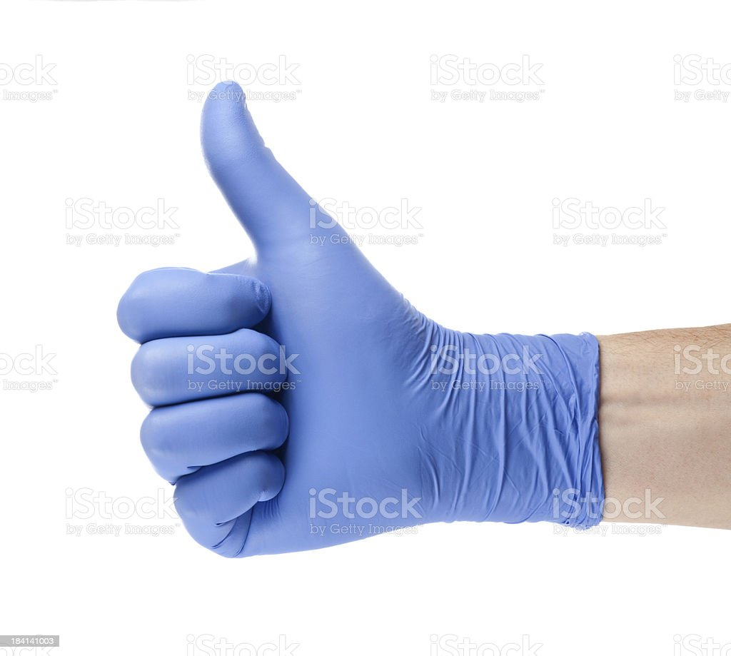 Hand in blue glove stock photo