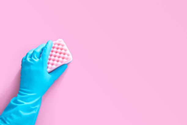 Hand in blue rubber glove holding pink cleaning sponge isolated on picture id1192655803?b=1&k=6&m=1192655803&s=612x612&w=0&h=j0hahtzxwrntcqpysc6rebpxourpfwmzxzy95bbtlds=