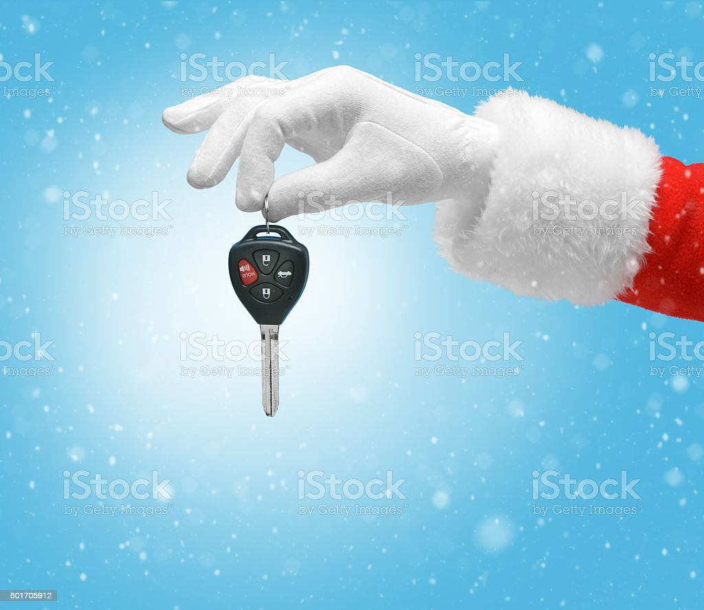 Hand in costume Santa Claus is holding car keys stock photo