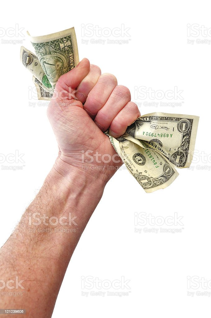 Hand in fist gesture holding dollar bills stock photo
