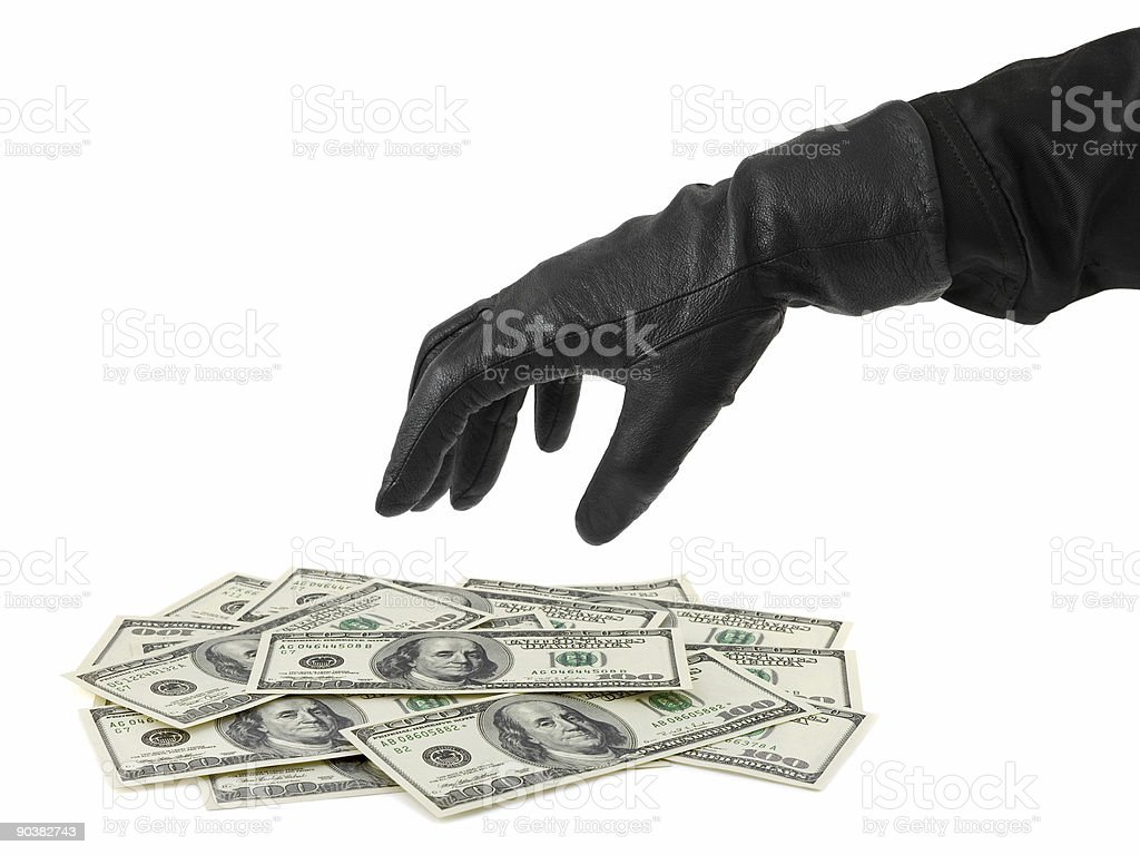 Hand in glove and money stock photo