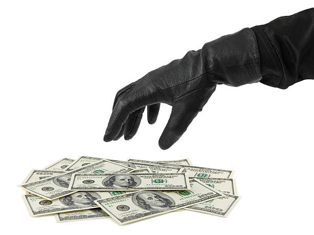 hand in glove and money - protective glove stock pictures, royalty-free photos & images