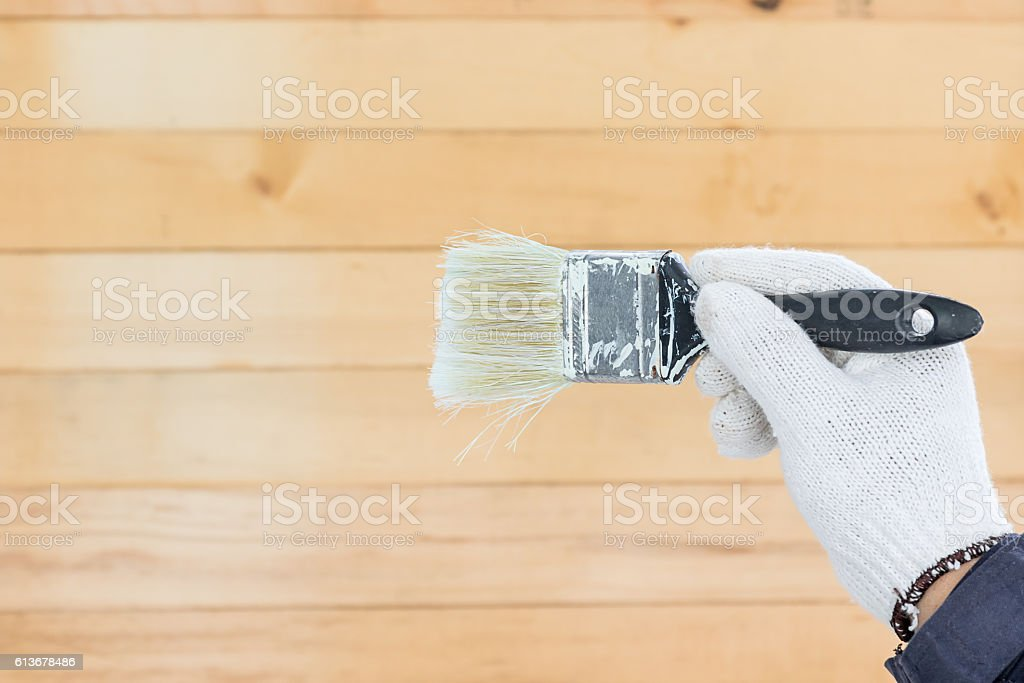 Hand in glove cotton holding brush paints stock photo