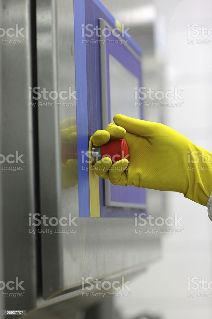 hand in glove touching technology button at control panel royalty-free stock photo