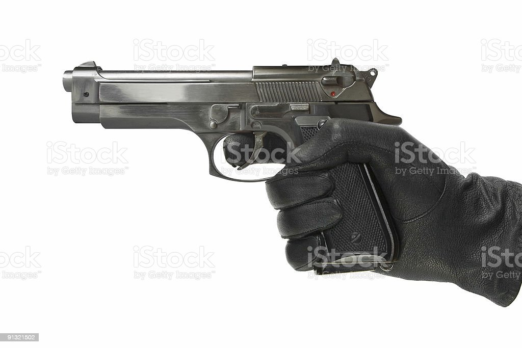 Hand in glove with pistol royalty-free stock photo