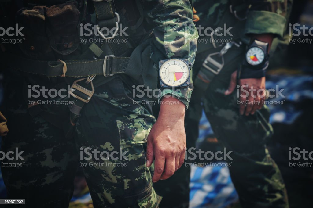 Hand in glove with the parachutist altimeter close up. stock photo