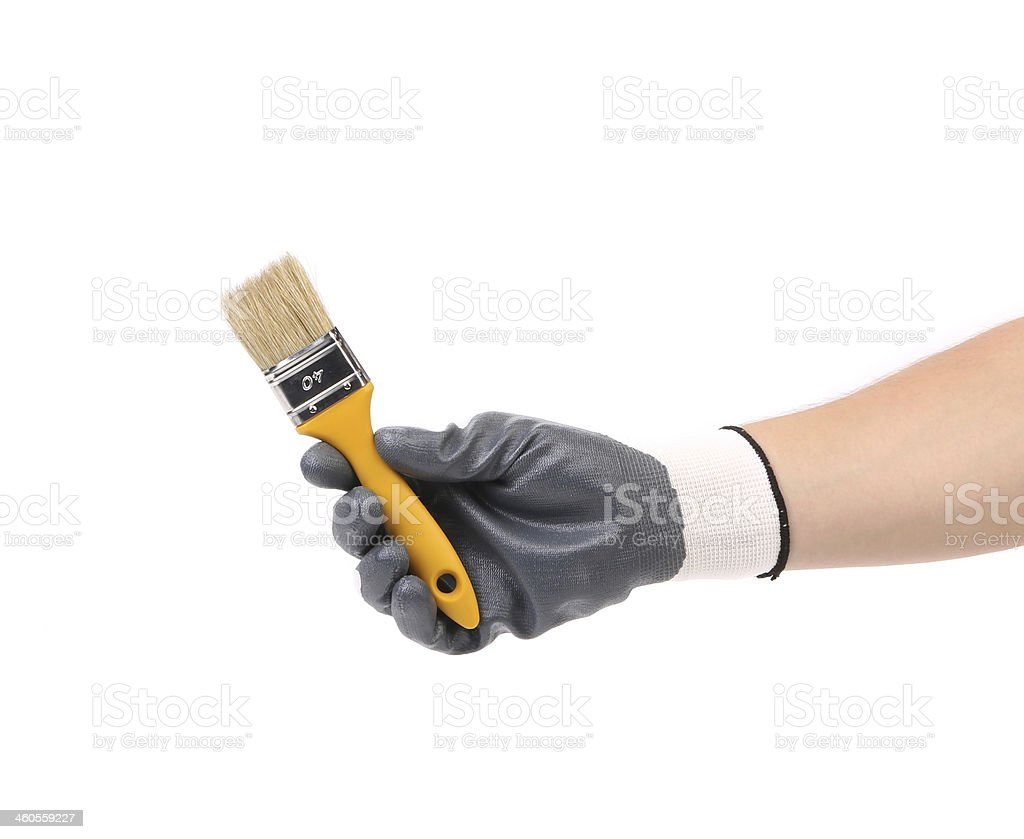 Hand in gloves holds brush. stock photo