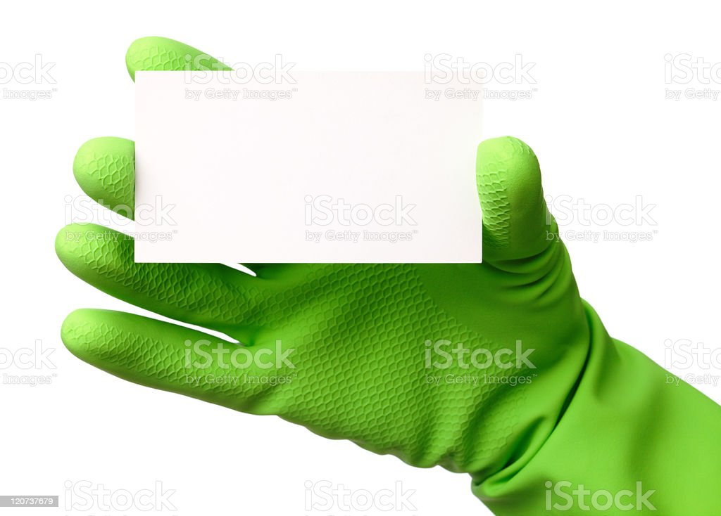 Hand in green glove showing business card stock photo