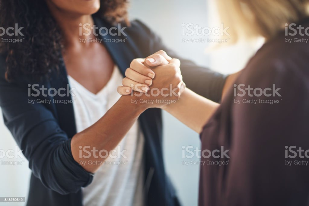 Hand in hand in the journey of success stock photo