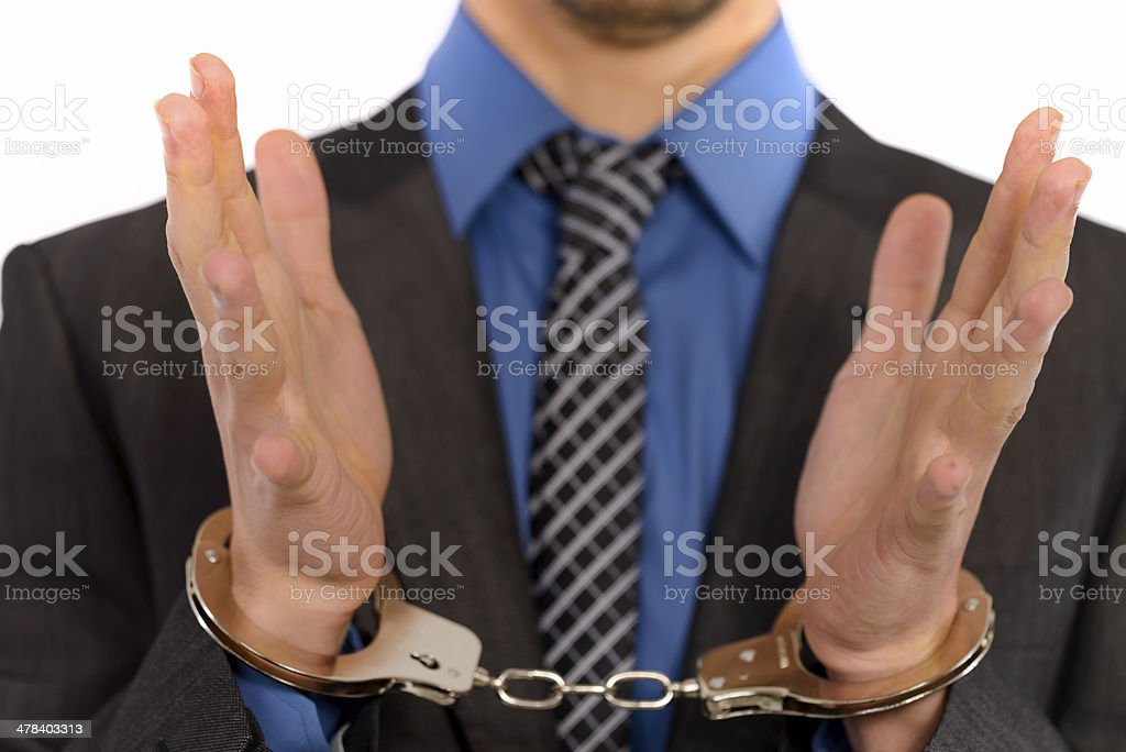 hand in handcuffs royalty-free stock photo