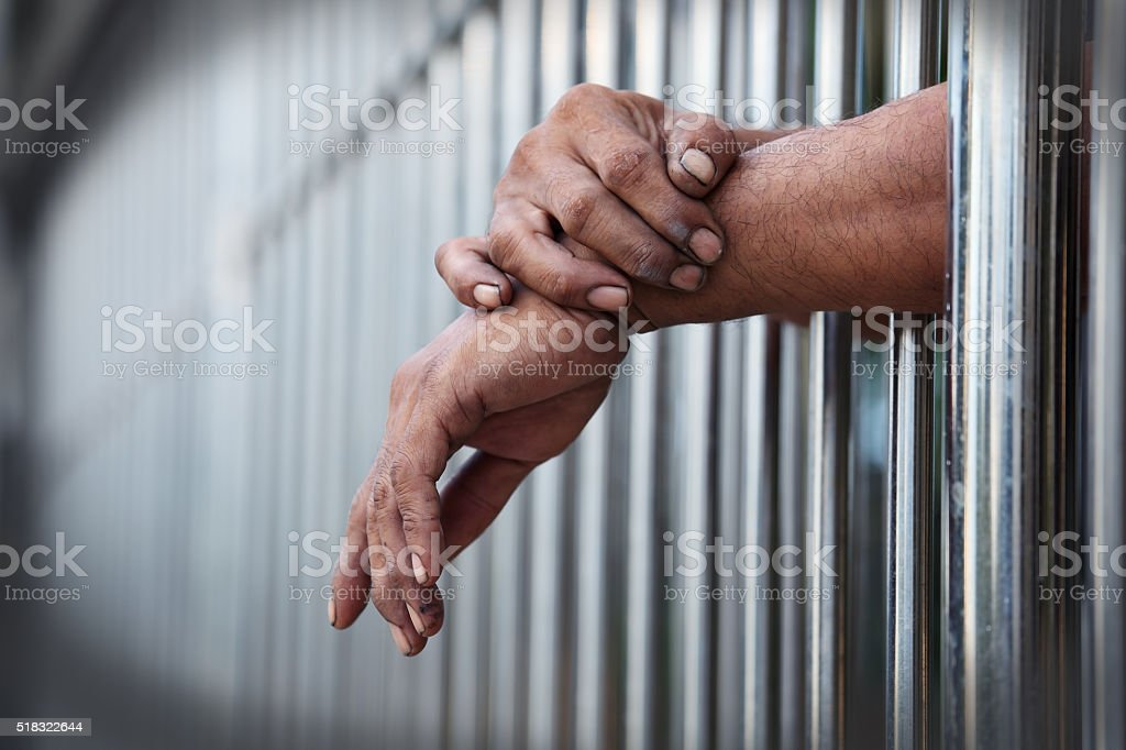hand in jail stock photo