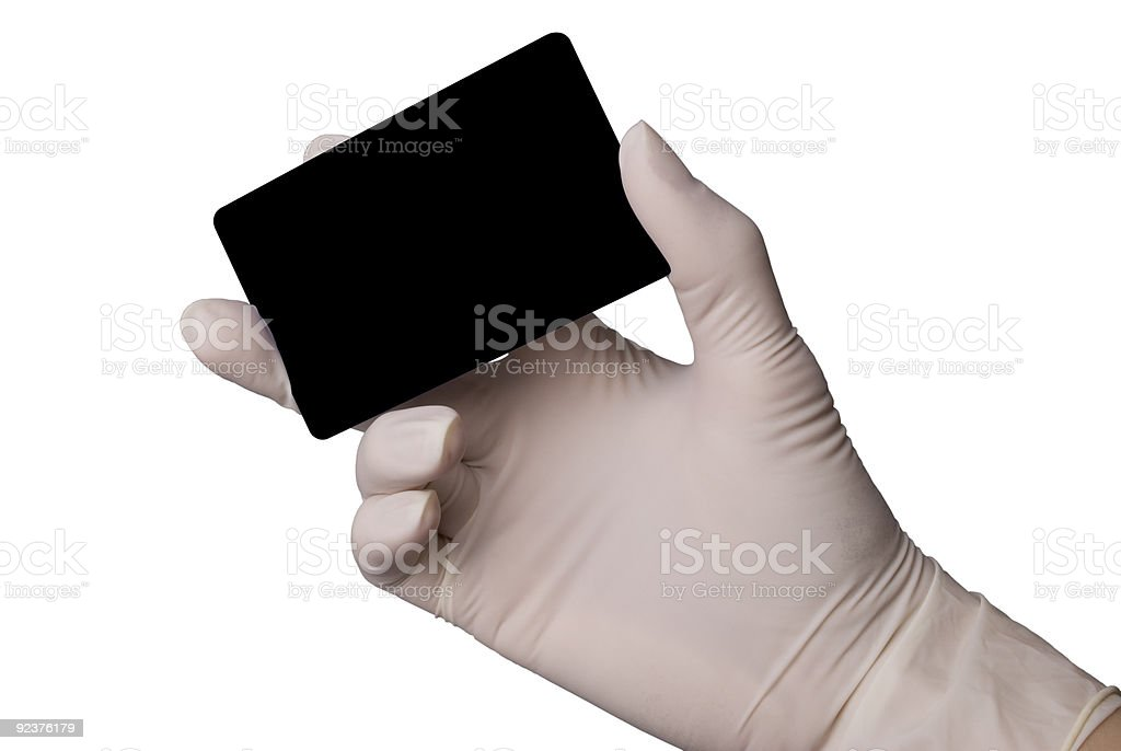Hand in latex medical glove holding a credit card royalty-free stock photo
