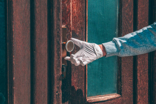hand in medical gloves opens door (covid-19) - lepro stock pictures, royalty-free photos & images