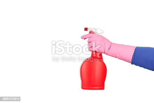 istock Hand in pink glove holding a spray for cleaning kitchen or bathroom isolated on white background 895432824