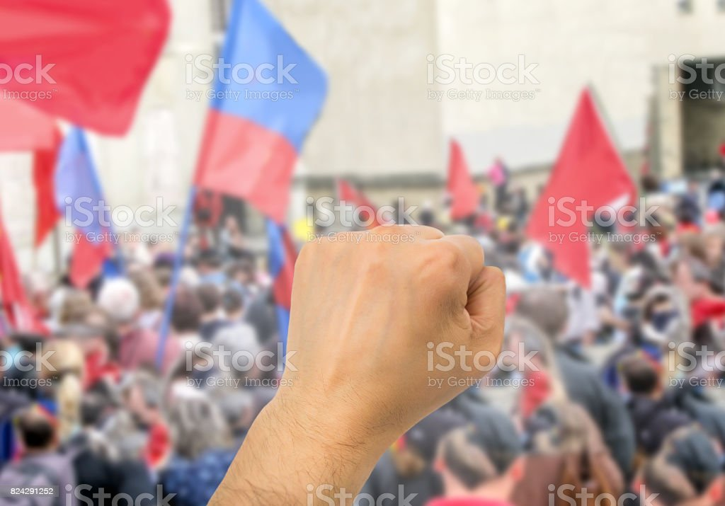 hand in protesting stock photo