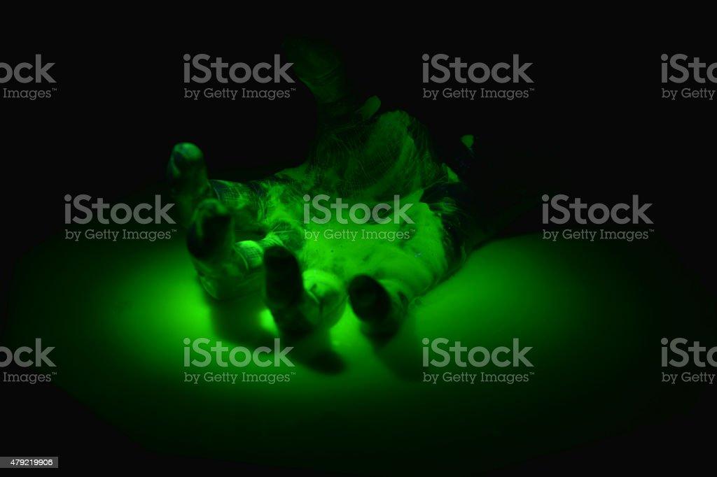Hand in radioactive waste stock photo