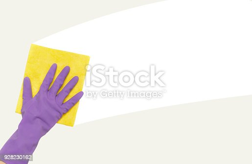 istock Hand in rubber glove wiping white wall from dust 928230162