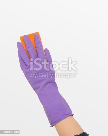 istock Hand in rubber glove wiping white wall from dust 958889108
