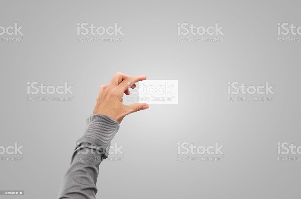 Hand in sweater jacket hold business card mock up. stock photo
