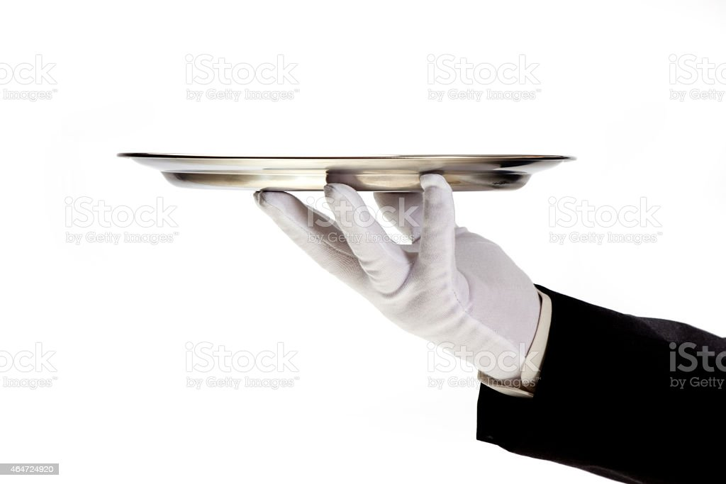 hand in white glove holding empty serving tray stock photo