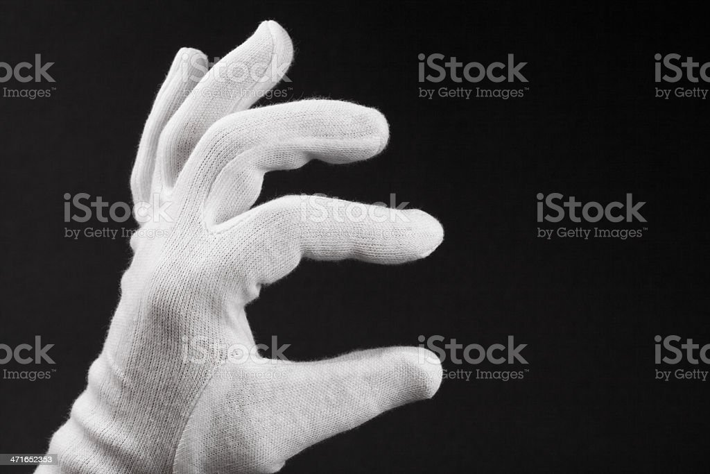 Hand In White Glove on Black stock photo