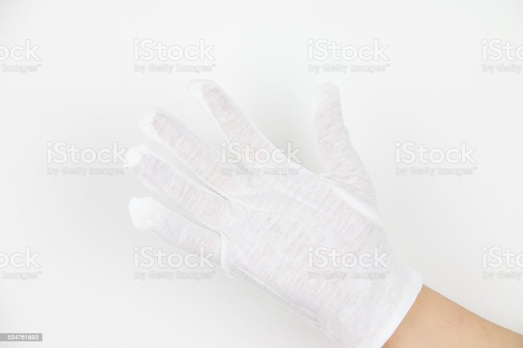 Hand in white glove stock photo