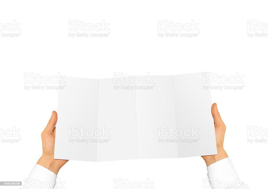 Hand in white shirt holding blank leaflet offset stock photo