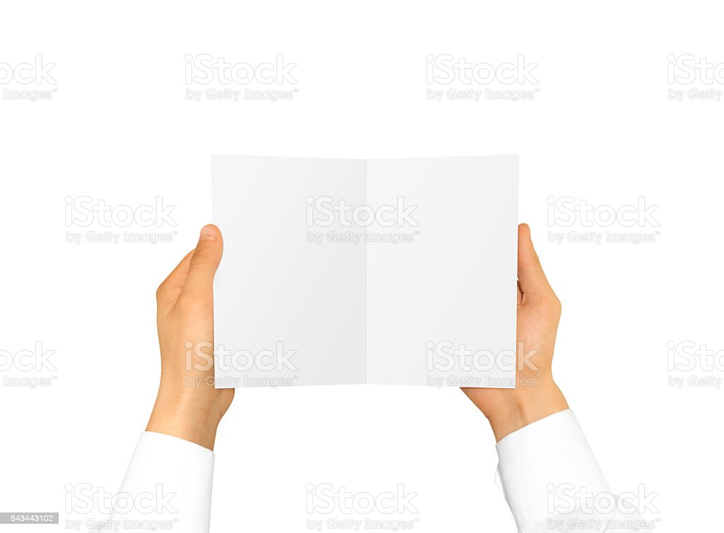 Hand in white shirt sleeve holding blank booklet card in stock photo
