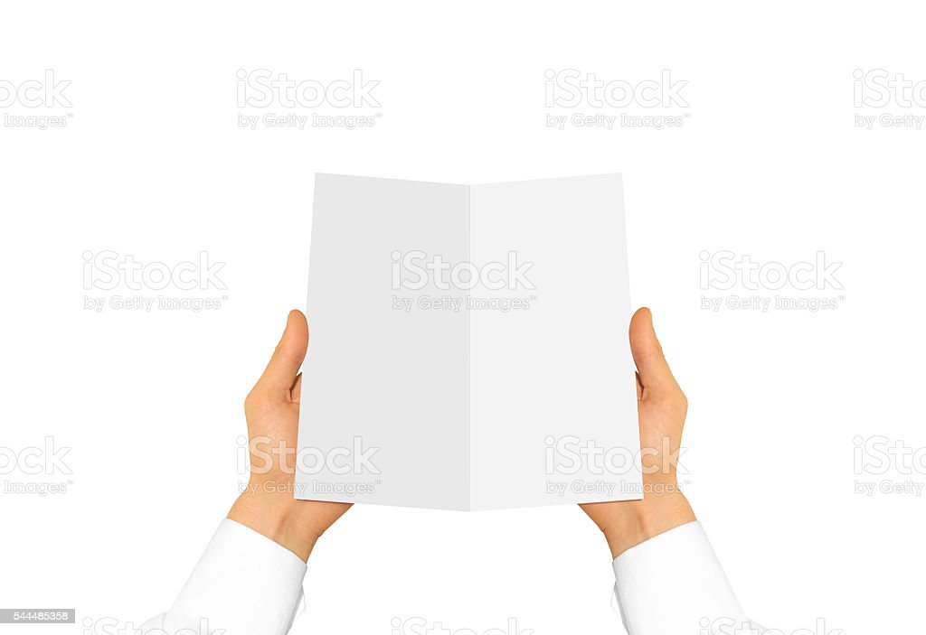Hand in white shirt sleeve holding blank leaflet stock photo