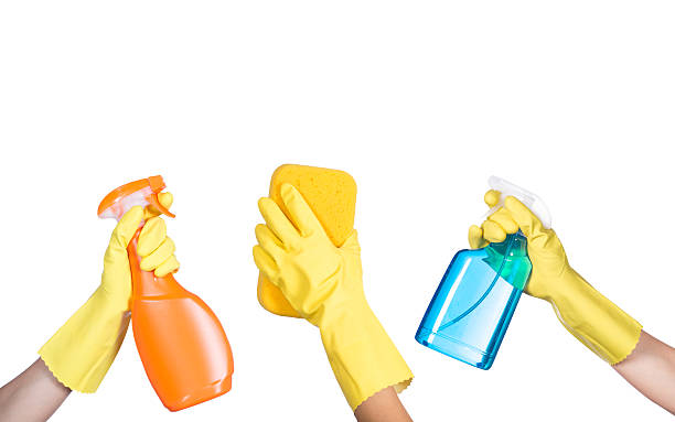 hand in yellow protective glove with cleaning product - waschhandschuhe stock-fotos und bilder