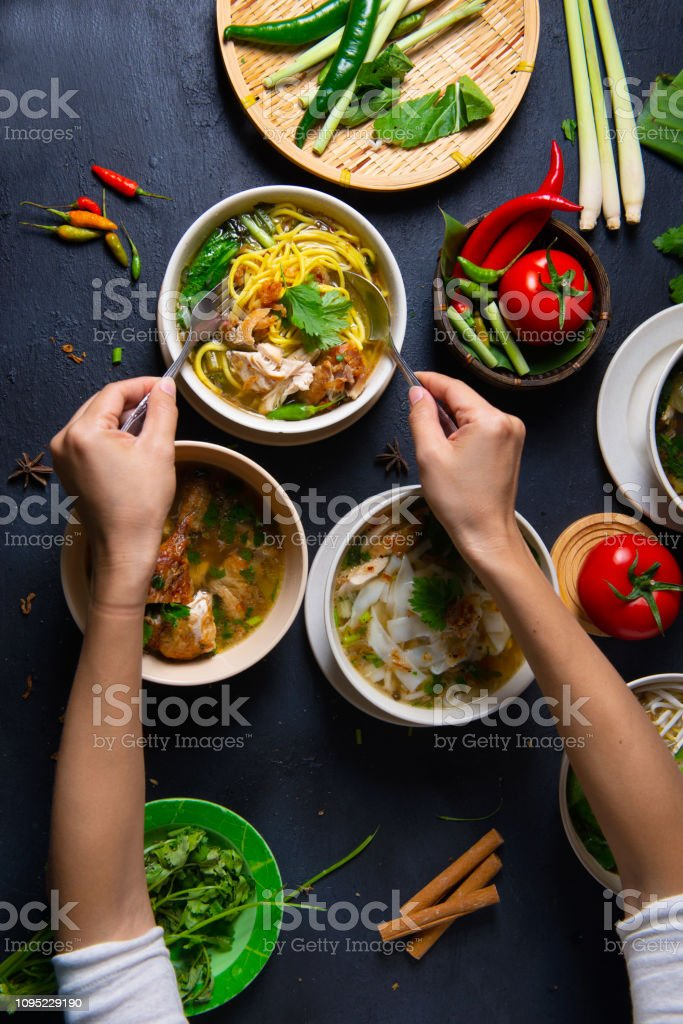 hand indulding on various malay foods stock photo