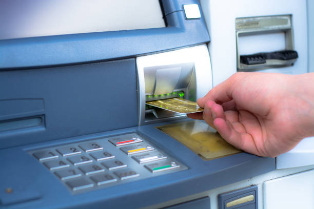 Hand inserting ATM credit card Hand inserting ATM credit card inserting stock pictures, royalty-free photos & images