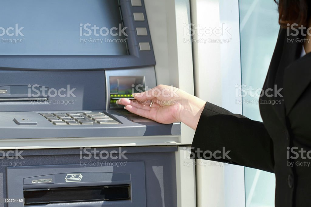 hand inserting card into cash dispense royalty-free stock photo