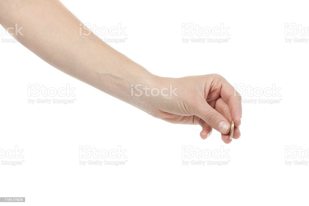 Hand inserting coin stock photo