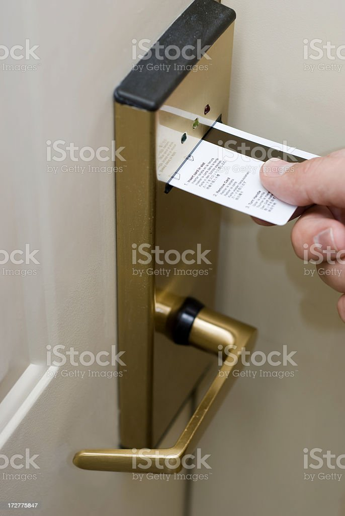 Hand Inserting Hotel Room Electronic Door Lock Keycard stock photo