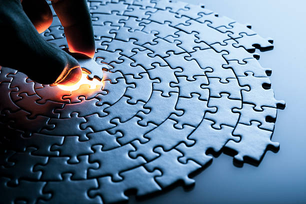 hand inserting missing puzzle piece - jigsaw puzzle stock photos and pictures