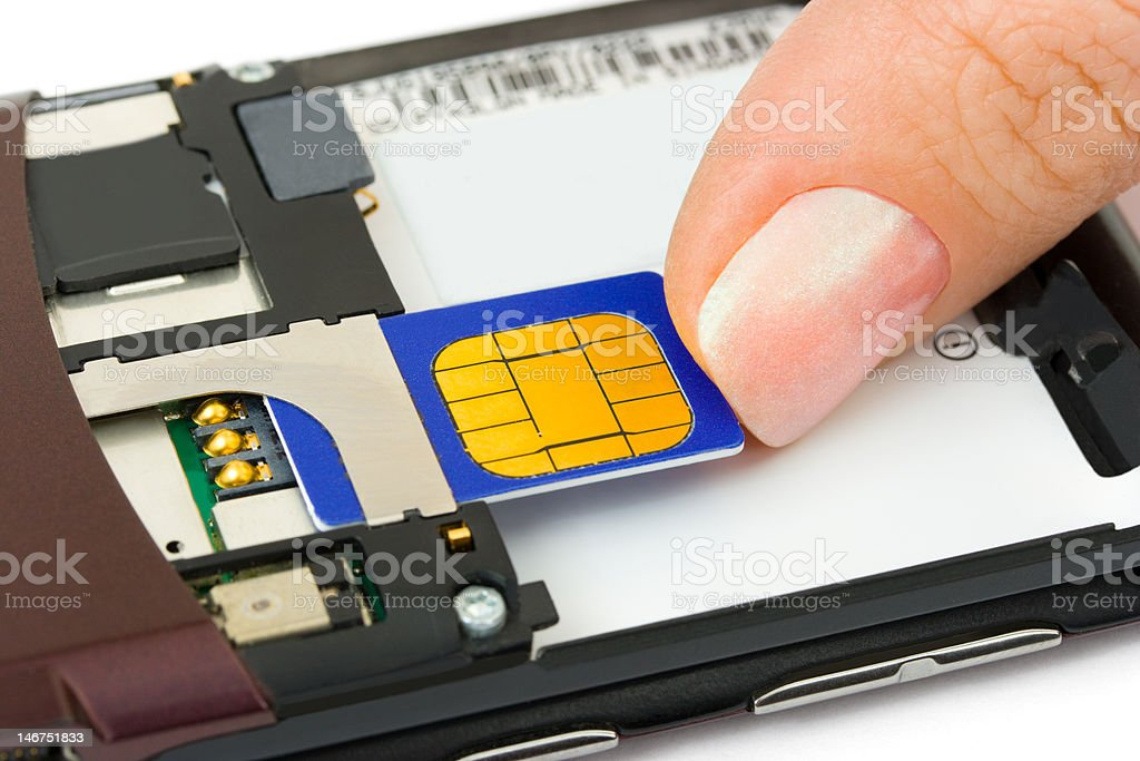 Hand install sim card to mobile phone stock photo