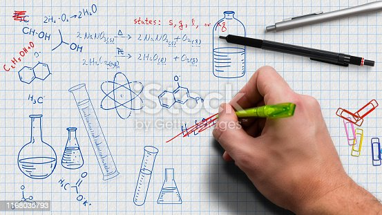 istock hand is drawing chemistry doodles 1168035793