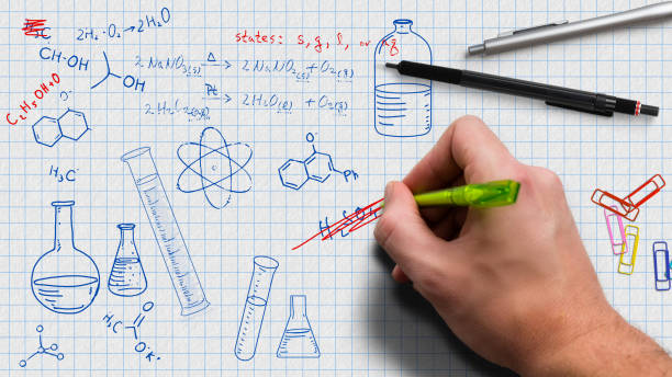 hand is drawing chemistry doodles hand is drawing chemistry doodles on paper chemical reaction stock pictures, royalty-free photos & images