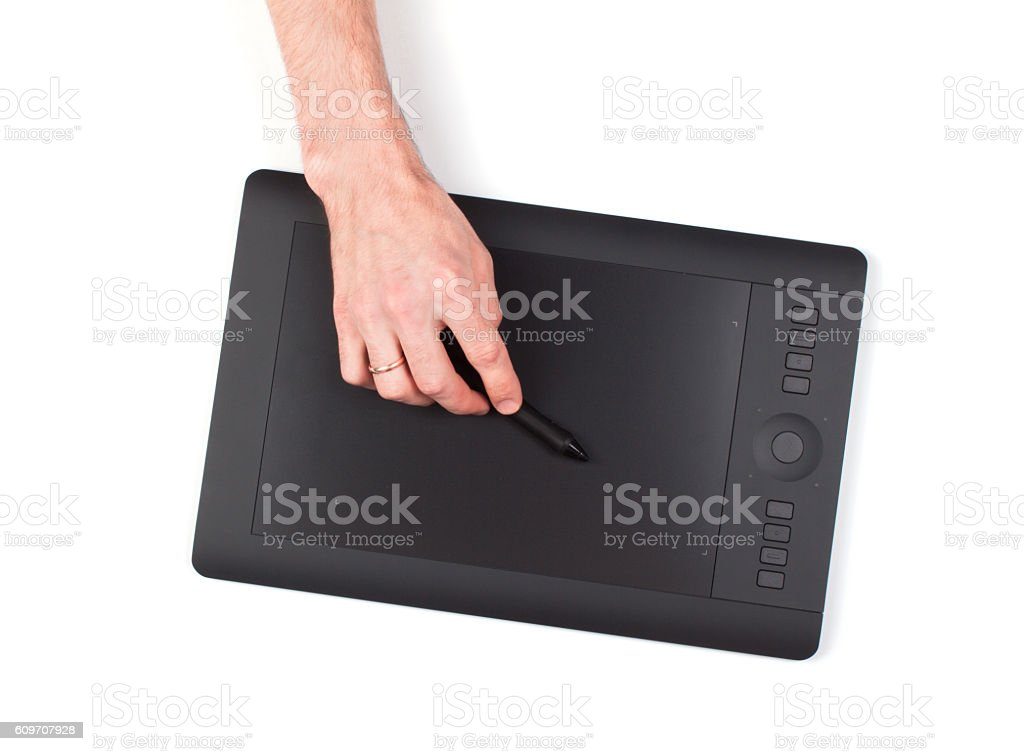Hand is drawing on a digital graphic tablet stock photo