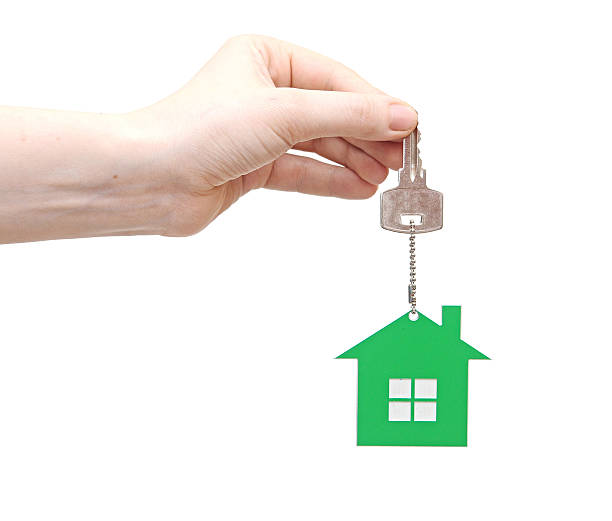 hand is handing a house key stock photo