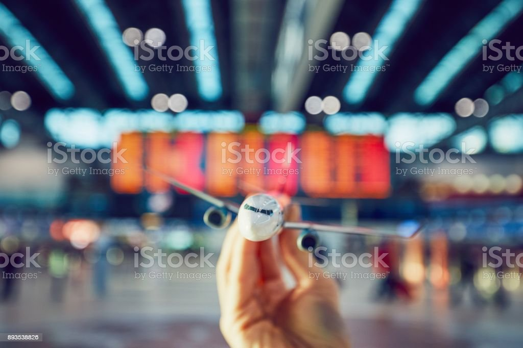 Hand is holding model airplan stock photo