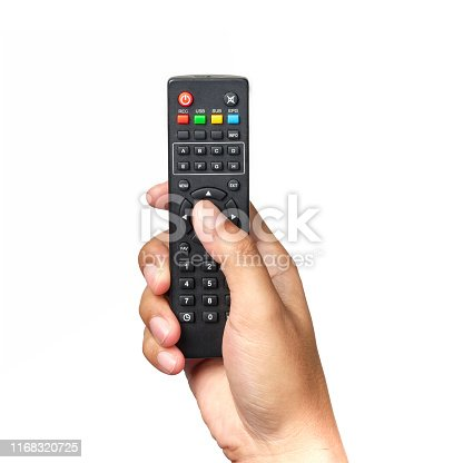 Hand is holding television remote control and pressing buttons isolated on white background.