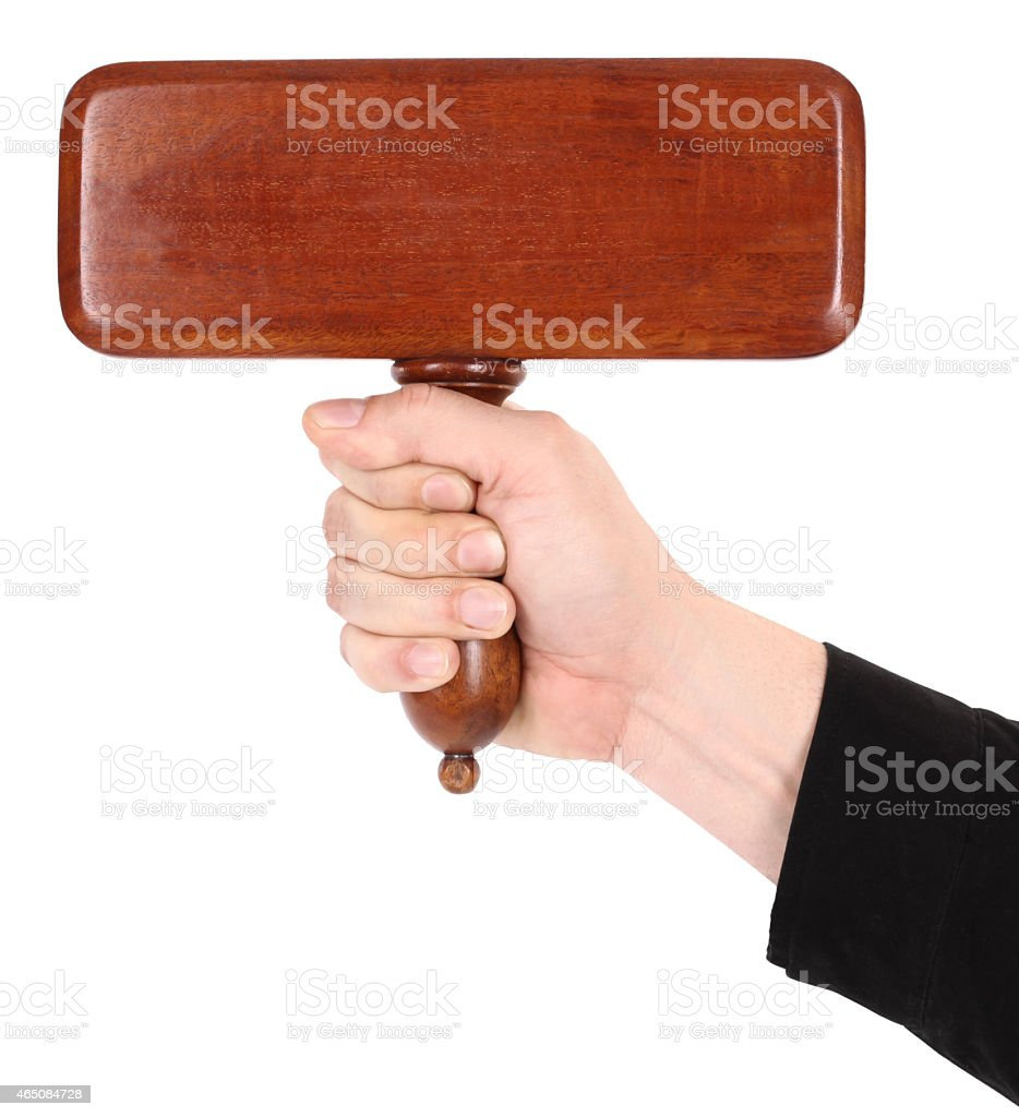 Hand is holding wooden sign board bid paddle stock photo