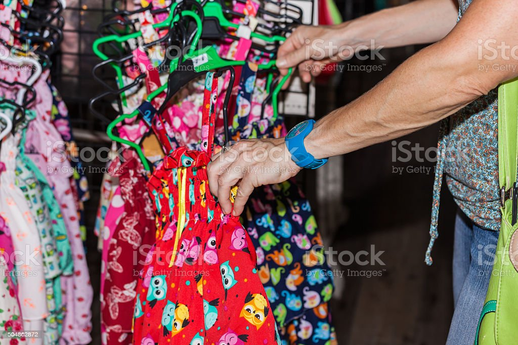 Hand, is looking at a market by children's clothes stock photo