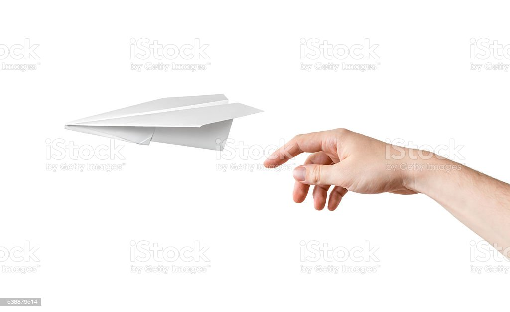 Hand is throwing origami paper airplane. Isolated on white background. stock photo