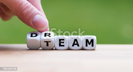 istock Hand is turning a dice and changes the word
