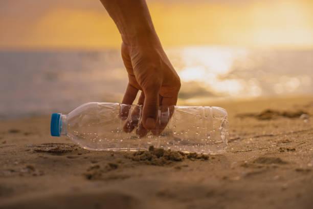 Hand keep cleanup the plastic bottle on beach at the sunset scene picture id1069645536?b=1&k=6&m=1069645536&s=612x612&w=0&h= xeawpy1fsh1xrp9wmei qe s2d8 o0p txaoyukzmk=