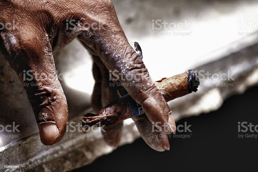 Hand keeping cigar royalty-free stock photo