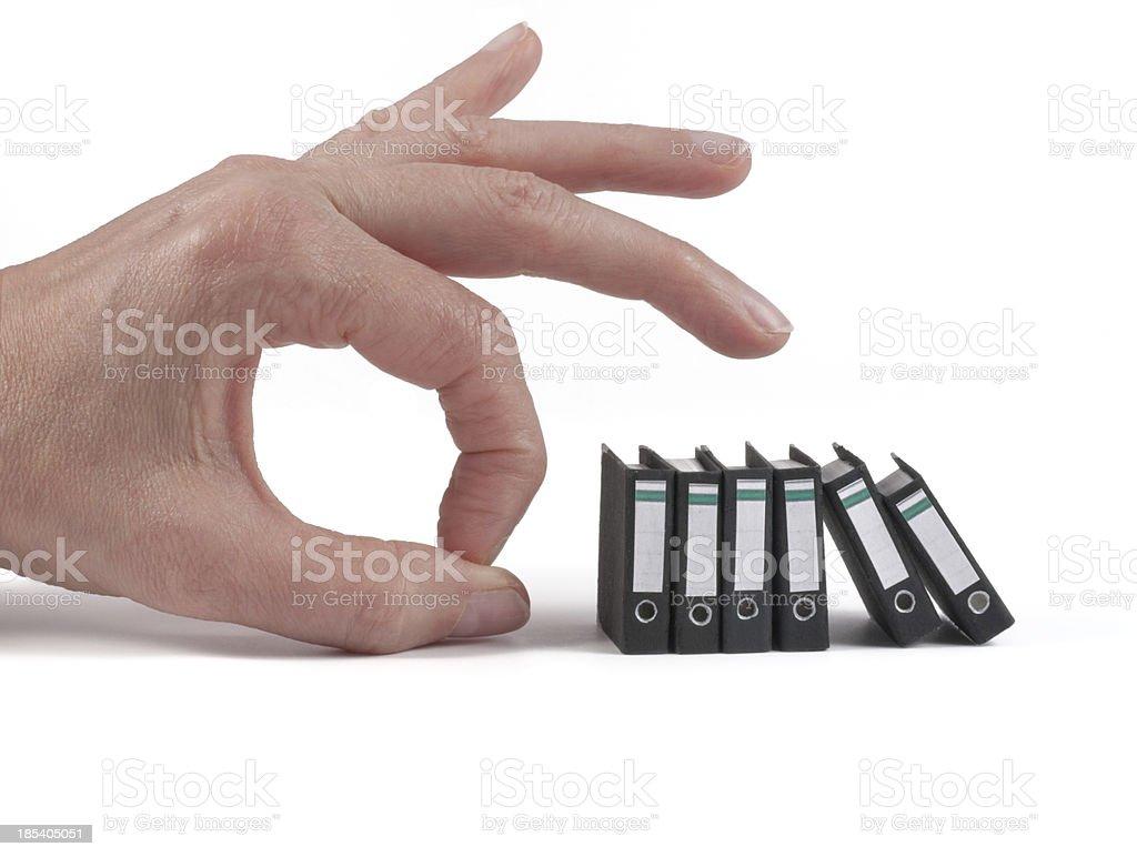 Hand kicking office folders stock photo